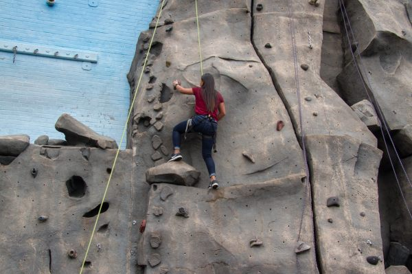 NWYLS Student on The Mountaineers Climing Wall